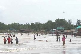 People take relaxation at Hseeintan Beach during office holidays