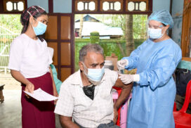 Above 45-year-old Bengalis receive COVID vaccines in Sittway