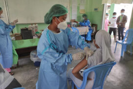 Above 18-year-old people receive COVID-19 vaccines in Myitkyina