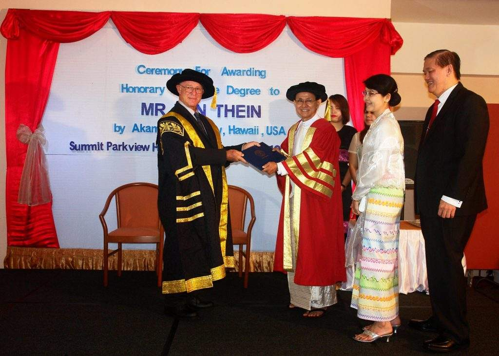 Officials confer honorary PhD in Educational Leadership on U Win Thein, former principal of Myanmar Mercantile Marine College.