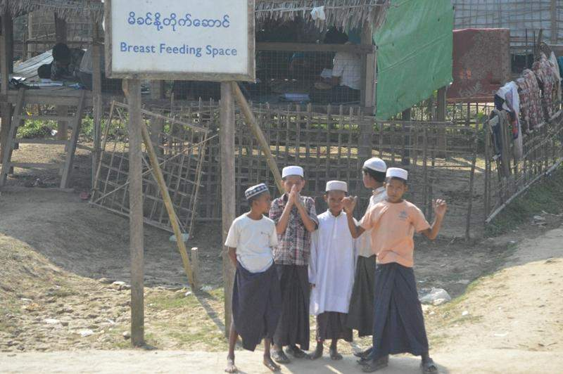 """A group of kids seen in front of breastfeeding space at Kyein-ni-pyin camp in Pauktaw Township on Monday. It is one of four in the township with 26,612 Muslim population. """"The camp sees health care services thrice a month,"""" said one of the heads of the camp.  GNLM/Photo: Ye Myint"""