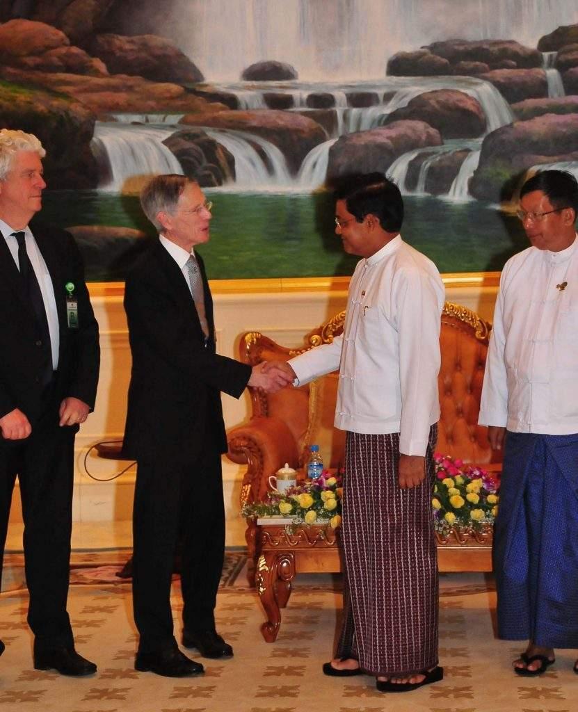 Vice President U Nyan Tun greets BG Group Sustainability Committee Chairman Sir David Manning.