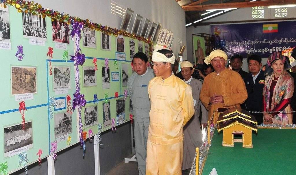 Vice President Dr Sai Mauk Kham views documentary photos on activities of  Shan New Year Day.