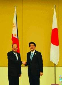 Prime Minister Shinzo Abe of Japan greets President  Benigno Aquino of the Philippines.