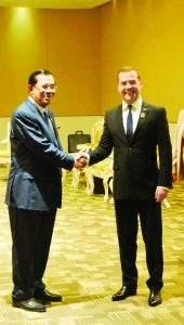 Russian Prime Minister Dmitry Medvedev shakes hands with  Prime Minister Samdech Hun Sen.
