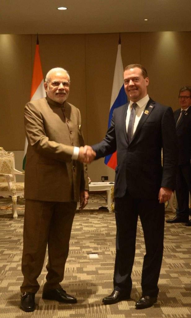 Indian Prime Minister Narendra Modi shakes hands with Russian Prime Minister  Dmitry Medvedev.—mna