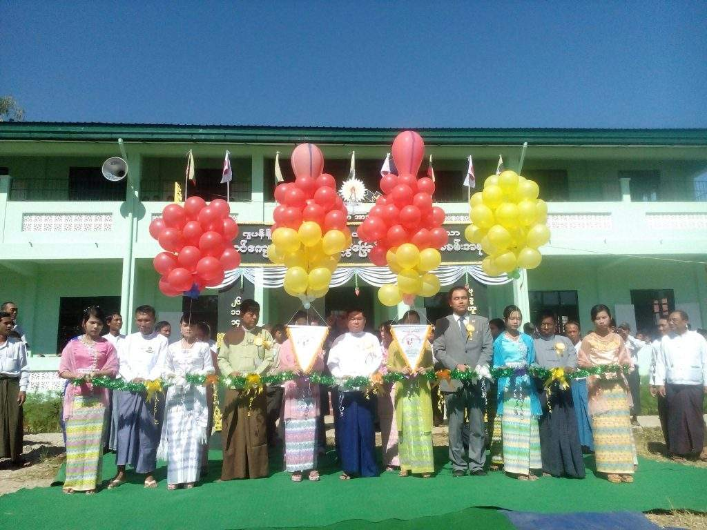 Japanese official and local authorities formally at handover ceremony of basic education school building.