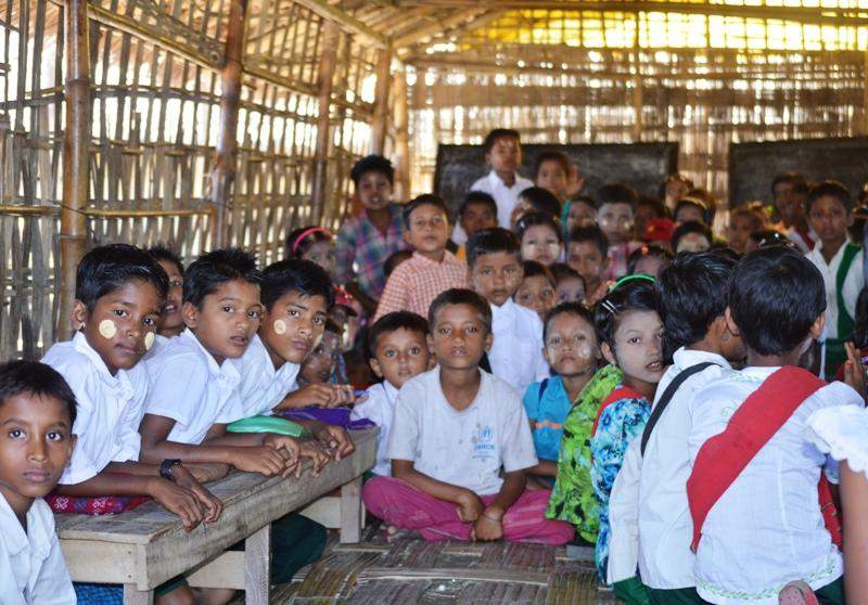 Photo taken on Thursday of students at a school in Sagartaung camp of Kyauktaw Township, 65-mile north of Sittwe, capital city of Rakhine State. A primary school is being kept open at the camp that houses about 600 victims, enabling schoolchildren to have access to education. In Kyauktaw, there are 12 camps for Muslim community.—GNLM/Photo: Ye Myint