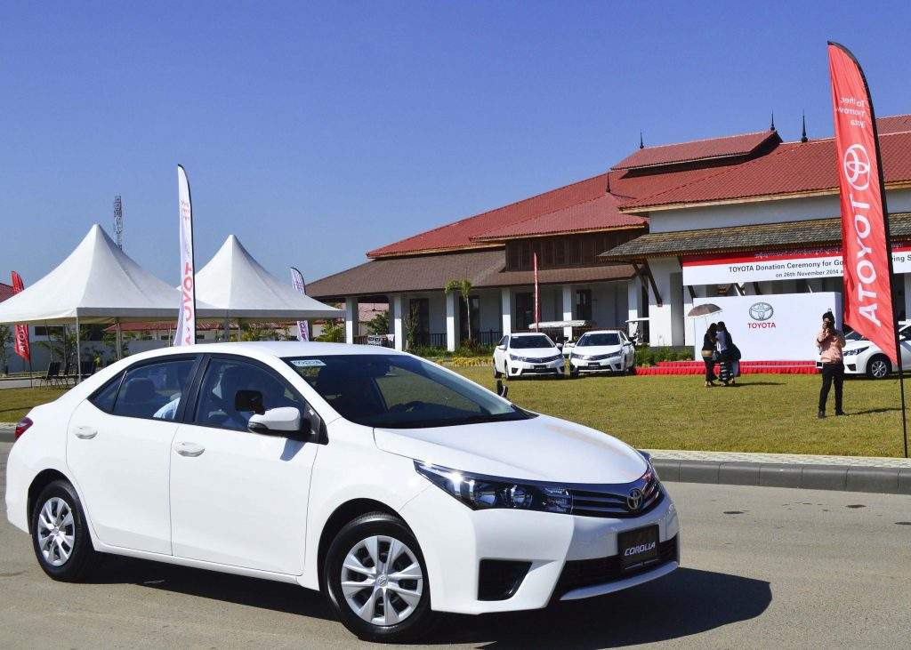 A Toyoda Carolla driving instructor car is test driven at a ceremony at which Toyota Motor Asia Pacific Pte Ltd donated 10 of the vehicles as well as driver safety materials and equipment to the government. Photo: Aye Min Soe