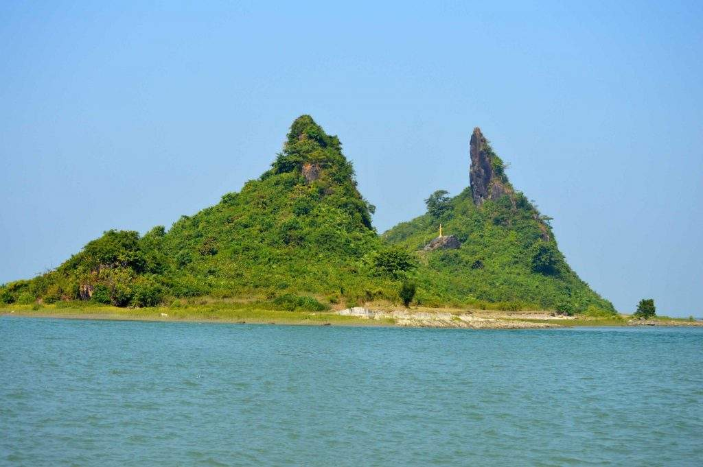Photo of a small island taken from a boat in the middle of Kisspanadi River (Kaladan River) in Rakhine State, western part of Myanmar.