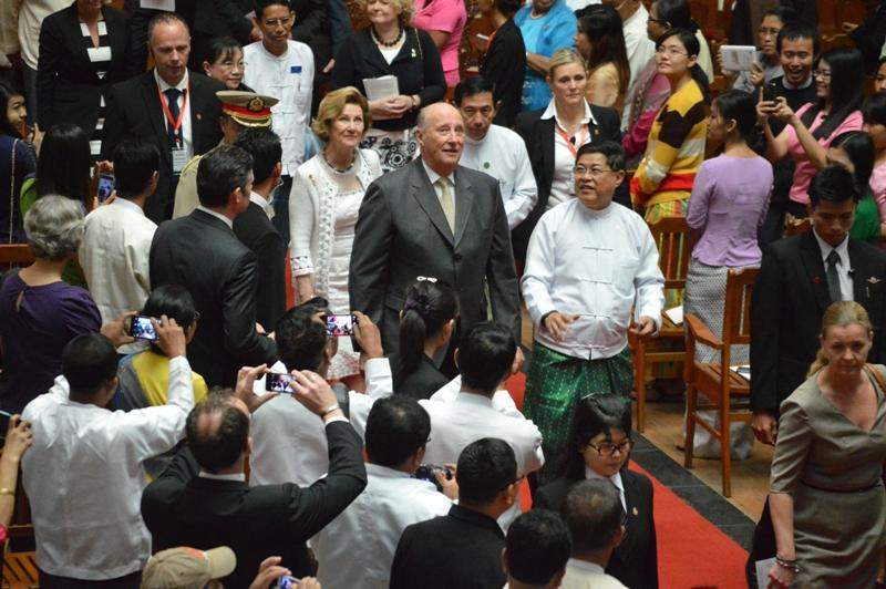 Accompanying Union Minister U Soe Thane and party, Norway's King  Harald V leaves after speaking at Convocation Hall at the University of  Yangon on Tuesday. King Harald V and Queen Sonja began a five-day state visit to Myanmar on Monday.—Photo: Ye Myint
