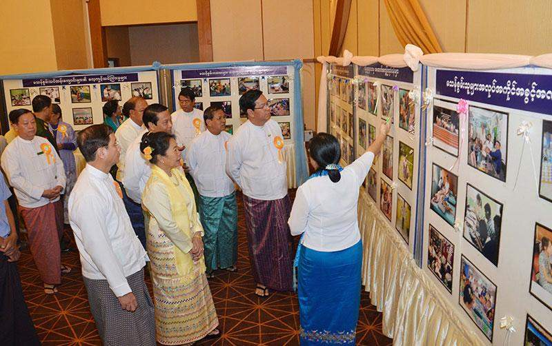 Union Ministers U Hla Tun, U Soe Win, U Khin Yi and  Dr Daw Myat Myat Ohn Khin view documentary photos on creating job opportunities for the persons with disabilities.