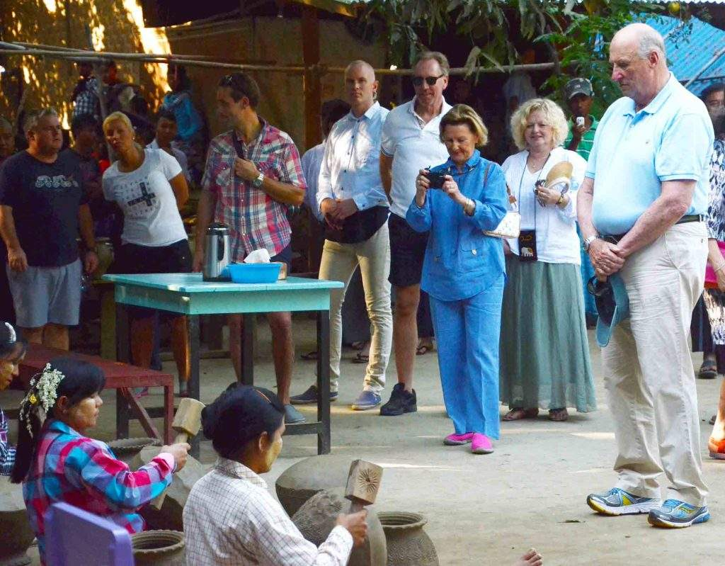 His Majesty King Harald V and Her Majesty Queen Sonja of Norway view production process of pottery in Yandabo Village,  Myingyan District.—Thura Zaw