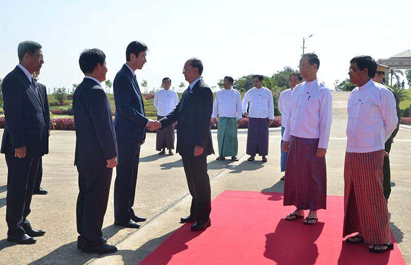 President U Thein Sein being seen off at Nay Pyi Taw Airport by  Vice Presidents Dr Sai Mauk Kham and U Nyan Tun, officials  and diplomats.—MNA