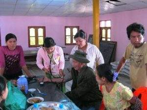 Doctors and health staff give medical checkup to a local at Myat Dana free clinic in Myanaung Township.