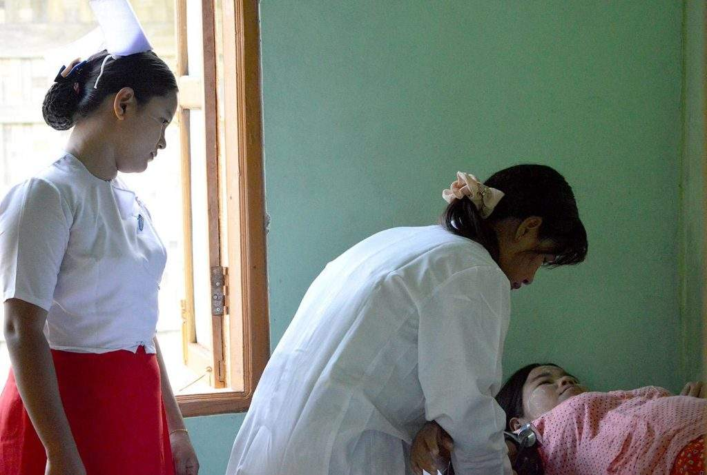 Photo of a pregnant woman having a thorough examination by a doctor at a local health centre in Myanmar where a health coverage plan is set to come next year.—Photo: Ye Myint