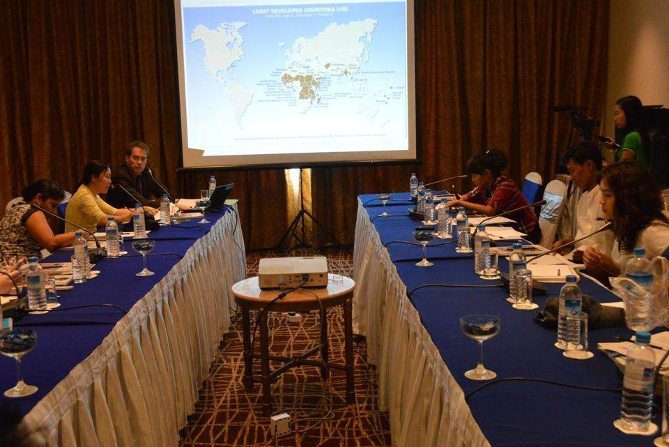 Igor Bosc, UNDP senior programme adviser, makes a presentation of the launch of the UNCTAD's Least Developed Countries Report 2014 at Sedona Hotel in Yangon on Monday.— GNLM/Photo Ye Myint
