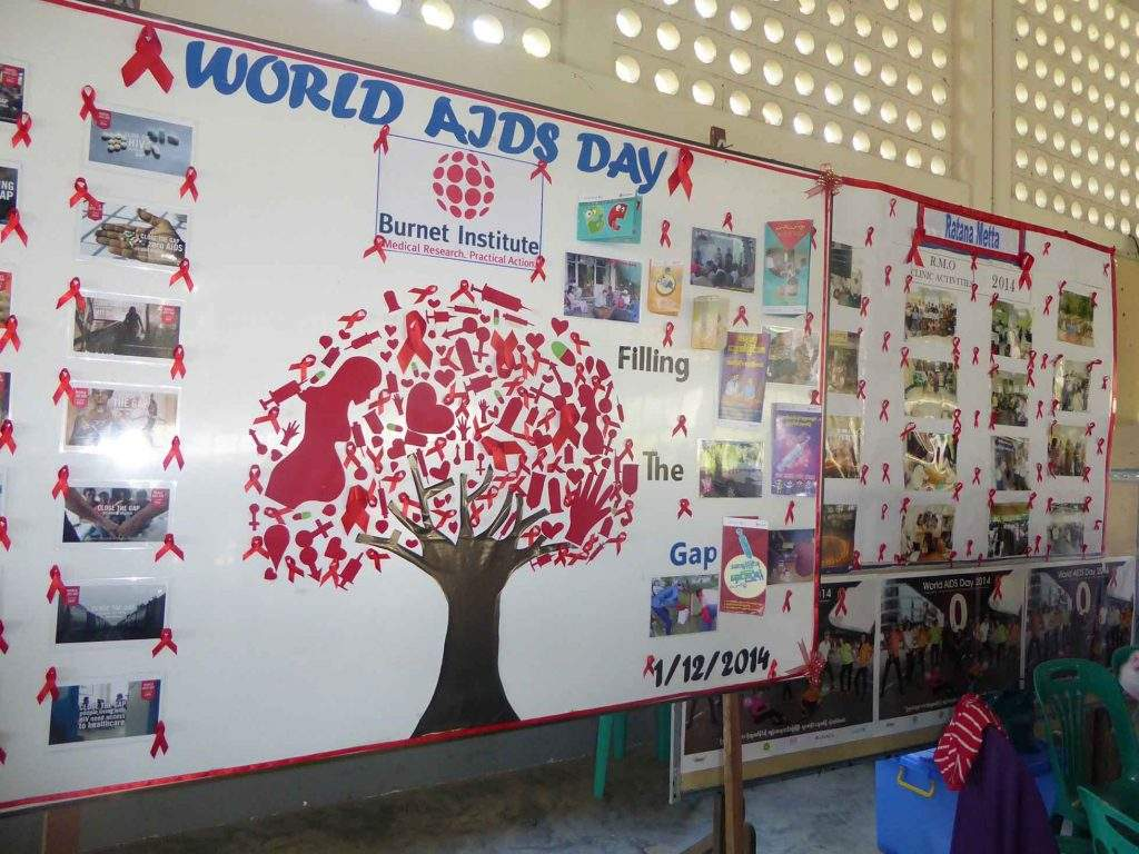 Photos and logos of AIDS depict World AIDS Day poster displayed at the ceremony at Ahlon BEHS-4 in Yangon. Photo: Khaing  Thanda Lwin