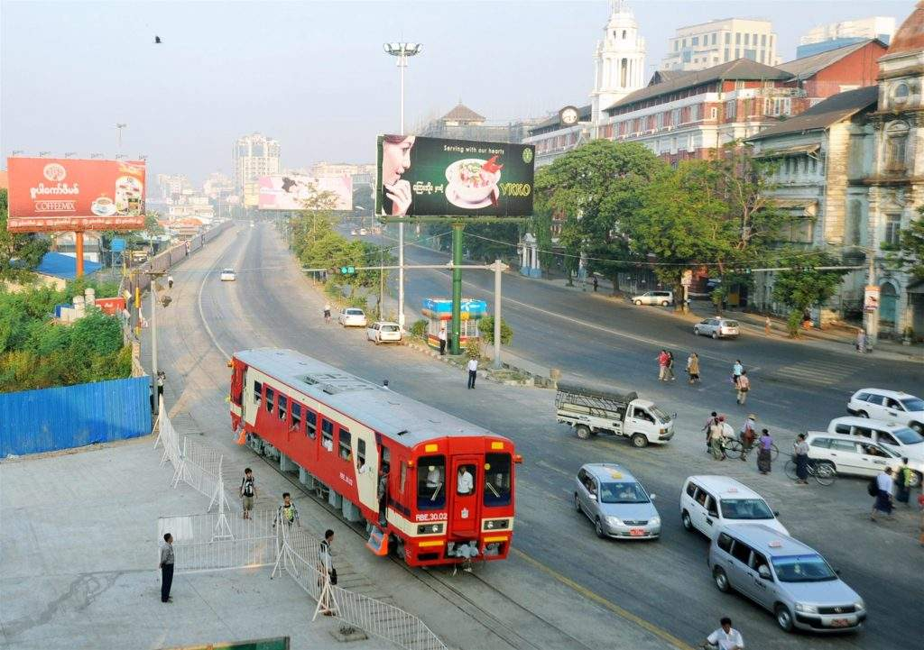 Newly launched RBE train seen in downtown Yangon.—Photo: Saw Thein Win