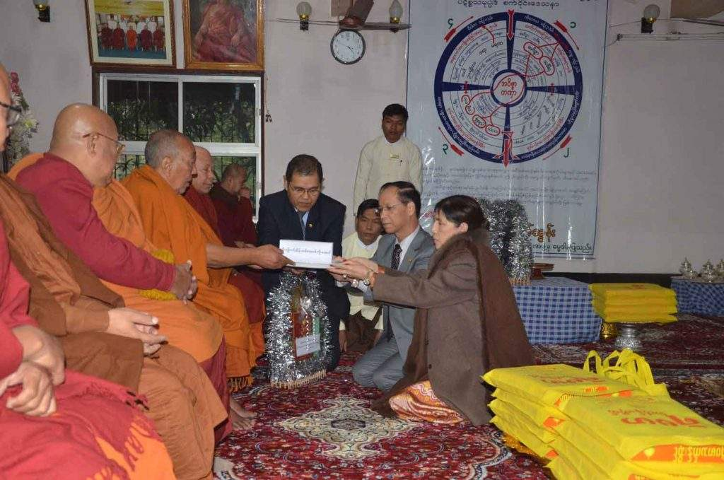 Vice President Dr Sai Mauk Kham and wife Daw Nan Shwe Hmon offer donation to abbots at  Myanmar monastery in Bodh Gaya, India.