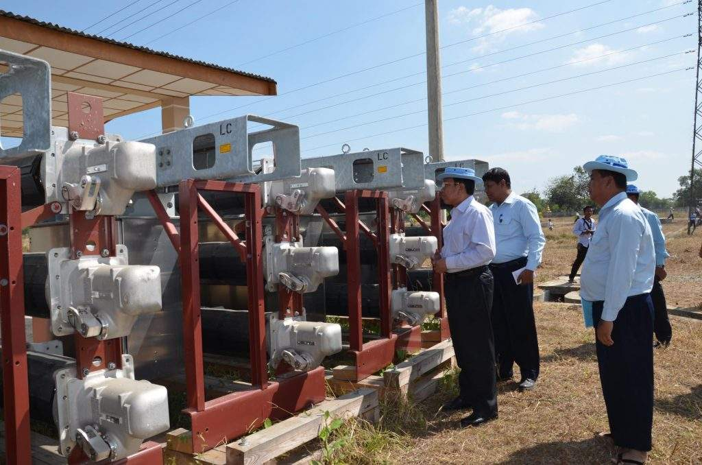 Union Minister for Electric Power U Khin Maung Soe inspects machine parts to be used at construction of power stations and power lines  in Ayeyawady Region.—mna