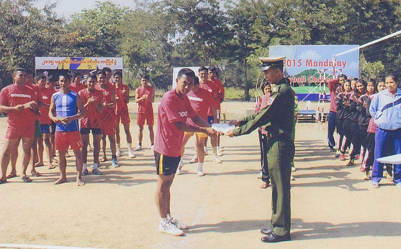 An official presents championship trophy to Central Command team.