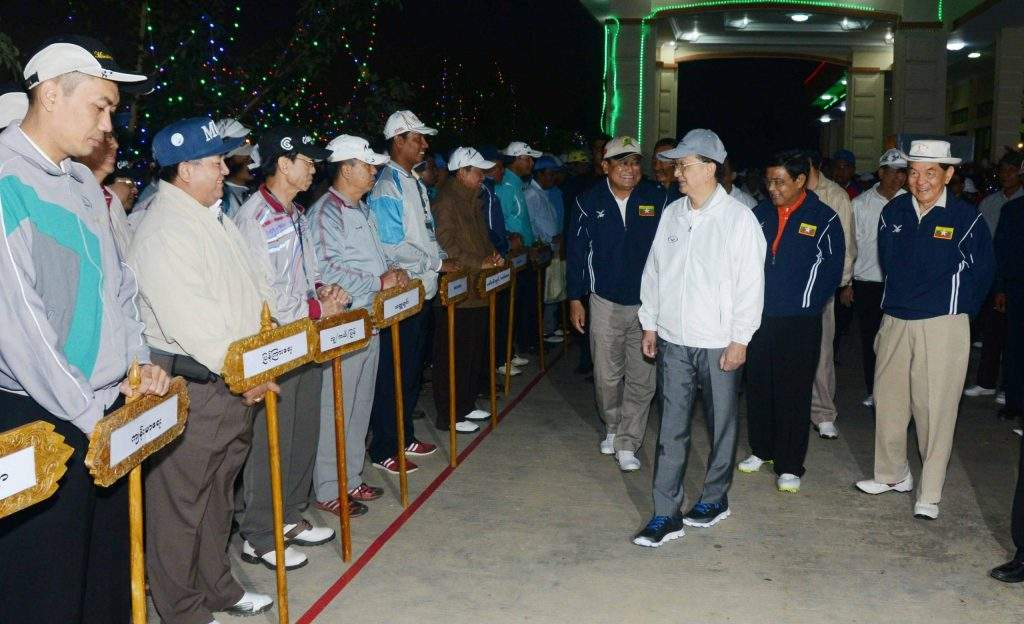 President U Thein Sein greets golfers who will be taking part in the third Union Government Cup Golf Tournament.