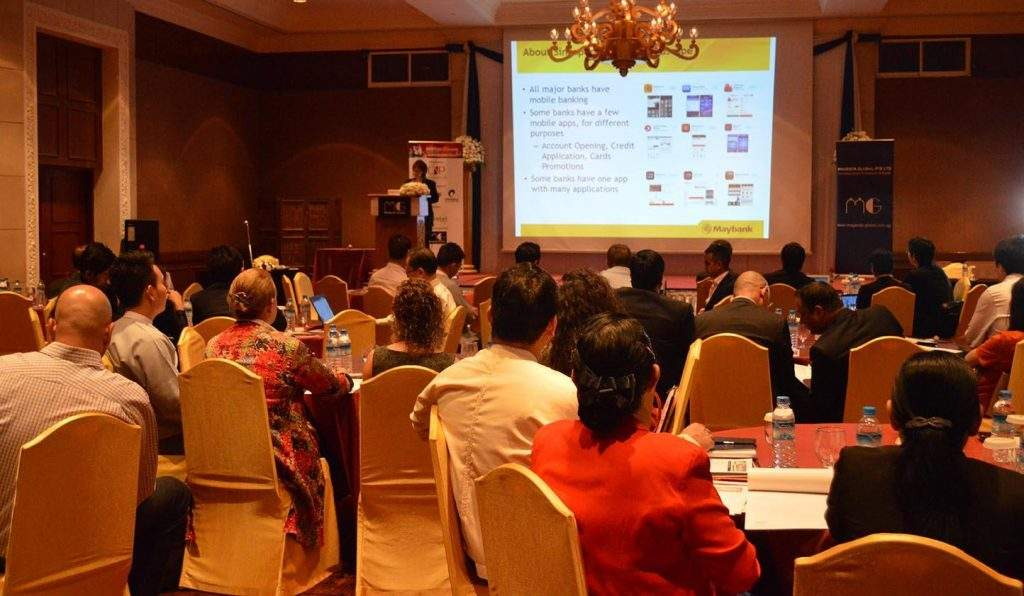 Cynthia Liaw, head of virtual banking & payments of Maybank, shares experience in mobile banking and mobile transfers at the 6th Annual Asia/Myanmar Mobile Money + E-Commerce Summit 2015 in Yangon on Wednesday.