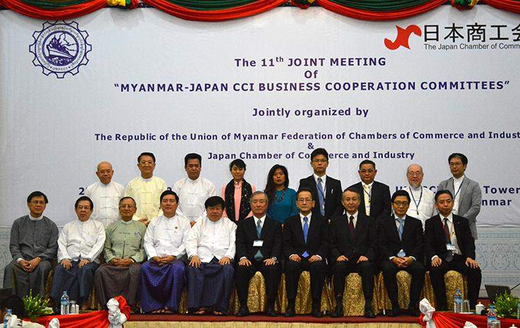 Attendees to 11th Joint Meeting of  Myanmar-Japan CCI Business Cooperation Committees pose for documentary photos in Yangon on Wednesday