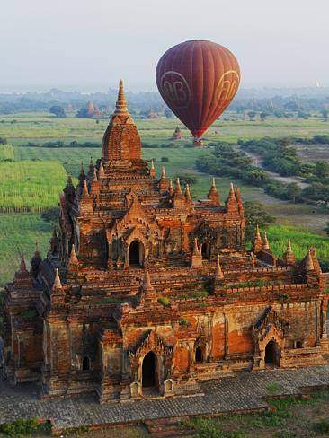 Photo of a hot-air balloon flying over one of  thousands of temples and stupas in Bagan,  Myanmar's main tourist attraction site.—Photo Credit to Crescent Moon Travels & Tours