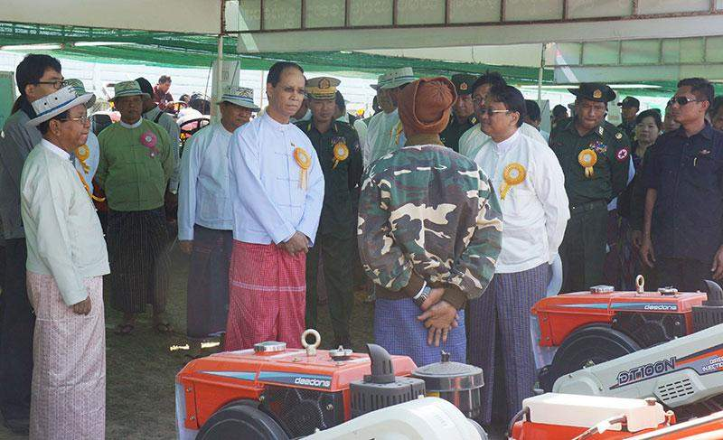 Vice President Dr Sai Mauk Kham visits booths of agricultural machinery at the ceremony of  socioeconomic development of people in Mawlamyine