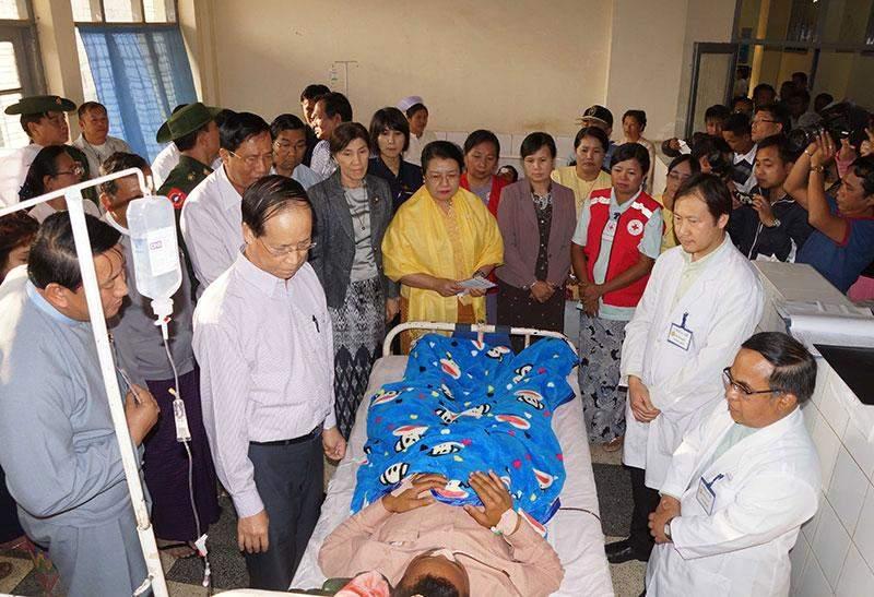 Vice President Dr Sai Mauk Kham comforts a patient at Lashio General Hospital in Lashio.