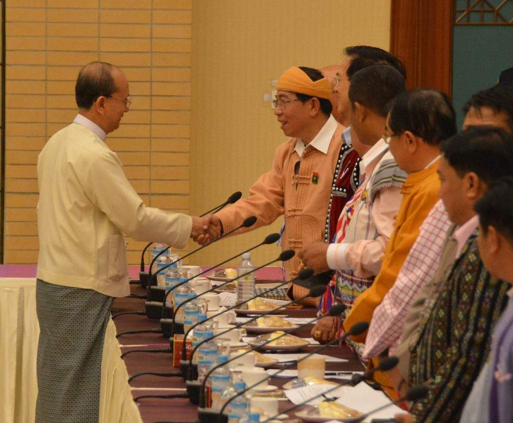 President U Thein Sein cordially greets one of the leaders of 13 armed ethnic groups at Myanmar International Convention Centre No 2.