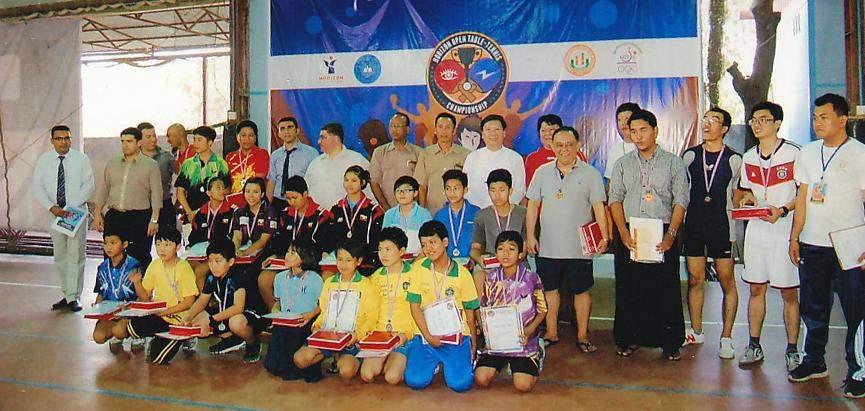 Winners pose for documentary photo in group at invitational tennis tournament organized bvy Horizon International School.