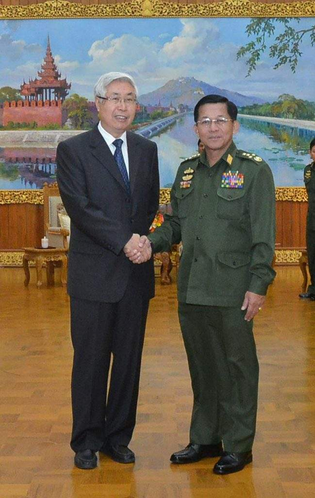 Senior General Min Aung Hlaing shaking hands with Mr Wang Yingfan, special envoy of China's Ministry of Foreign Affairs .—mna