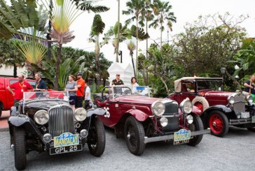 Convoy of classic cars heading towards ancient Myanmar city