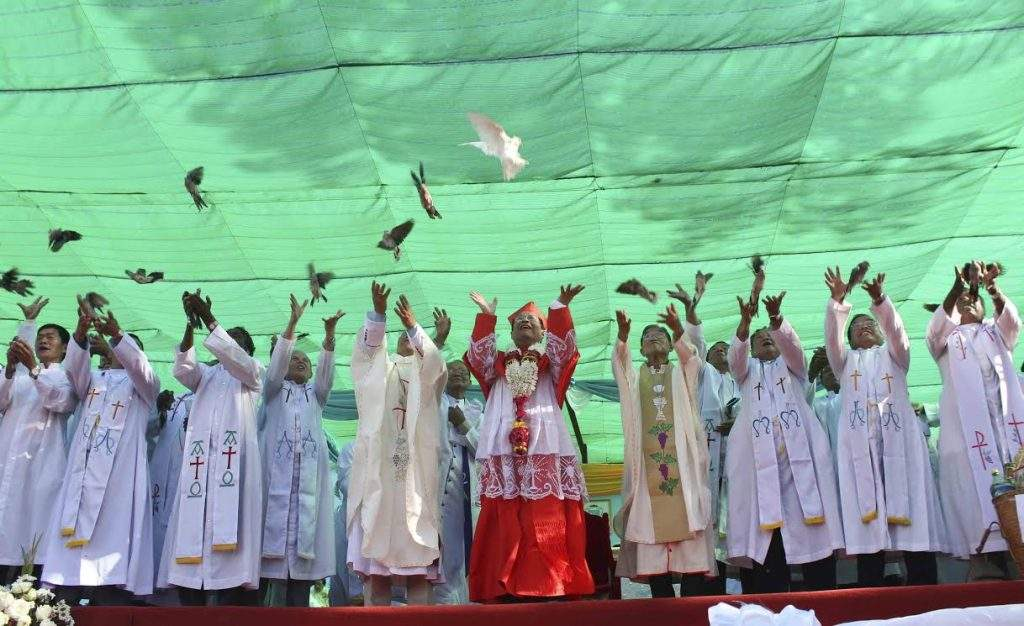 Cardinal Charles Maung Bo (centre), Bishops and Priests release doves for peace at the 113th annual National Marian Pilgrimage in Nyaunglebin.
