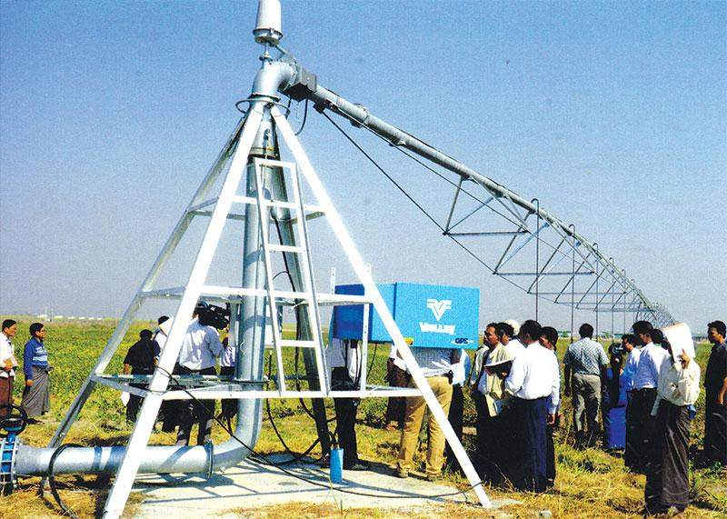 Technicians use modern pivot irrigation system in growing crops in farmlands in  Wethtigan Station, Pyay Township.