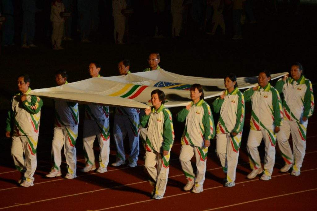 Flag bearers from the Ministry of Sports carrying National Sports flag from Wunna Theikdi stadium.—MNA