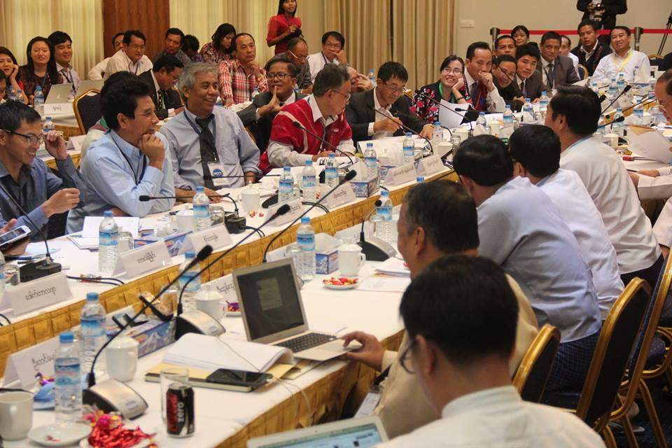 Peace negotiators from the NCCT and UPWC engage in discussions on the fifth day of the seventh round of nationwide ceasefire accord talks on Saturday. The fifth-day meeting concluded Chapter 5 of the accord.