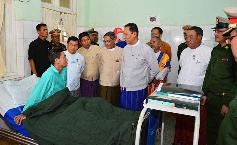 Speaker Thura  U Shwe Mann comforts an njured military  serviceman at  PyinOoLwin Military Hospital.