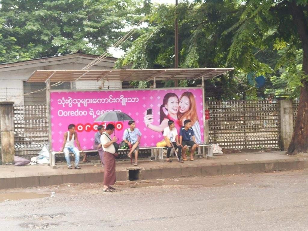 Ooredoo billboard seen hanging at a bus stop in downtown Yangon. Photo: Khaing Thanda Lwin