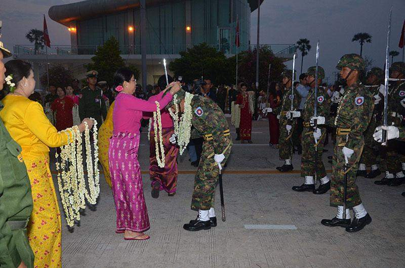 People garlands military servicemen of parade columns.