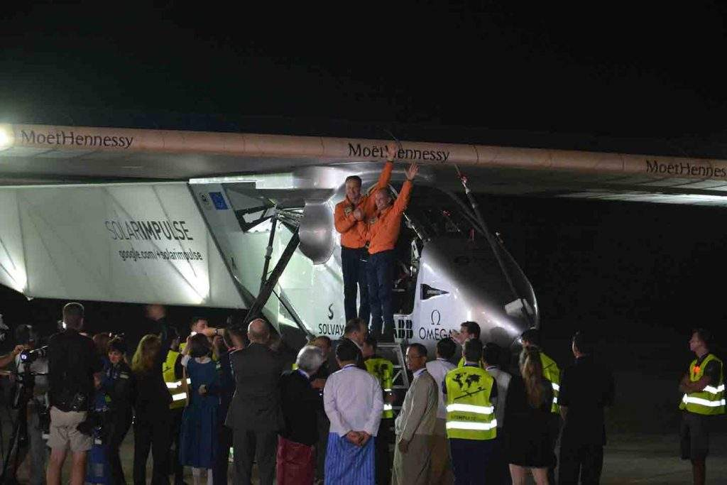 Solar Impulse-2 pilots wave at the welcoming party.—MNA