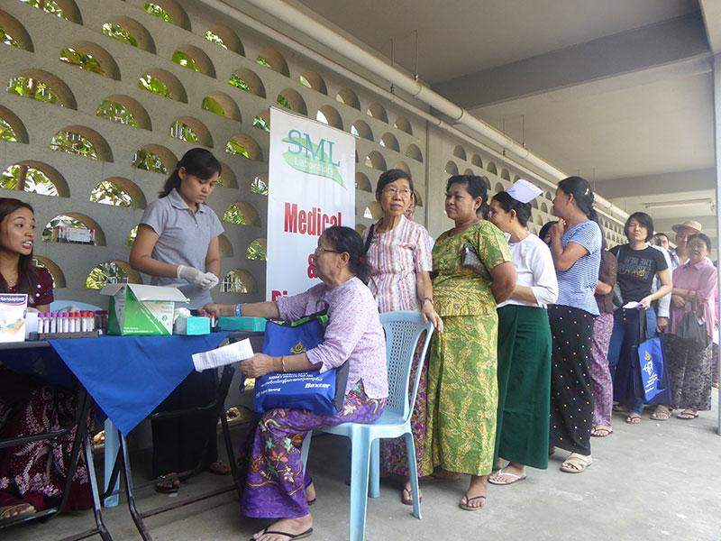 Health care providers give free medical check-up to attendees at a ceremony to mark the World Kidney Day in Yangon.—Photo: Khaing Thanda Lwin