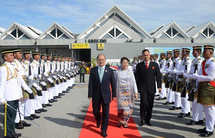 President U Thein Sein and wife Daw Khin Khin Win being seen off by officials at Langkawi Airport in Malaysia.