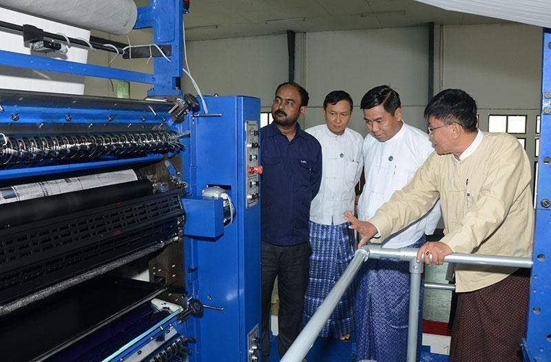 Deputy Minister for Information U Pike Htway views newly-operated offset printing press at Nay Pyi Taw Tatkon.—mna