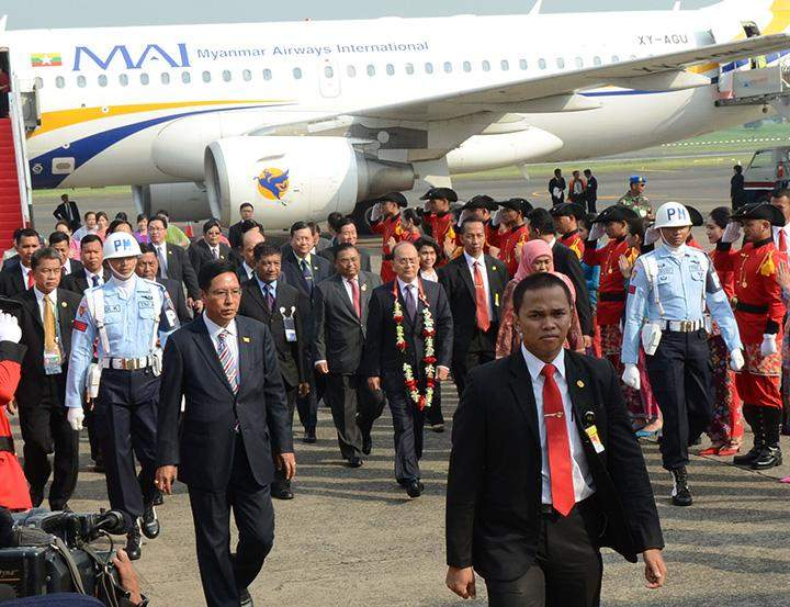 President U Thein Sein being welcomed by officials on his arrival in Jakarta, Indonesia.