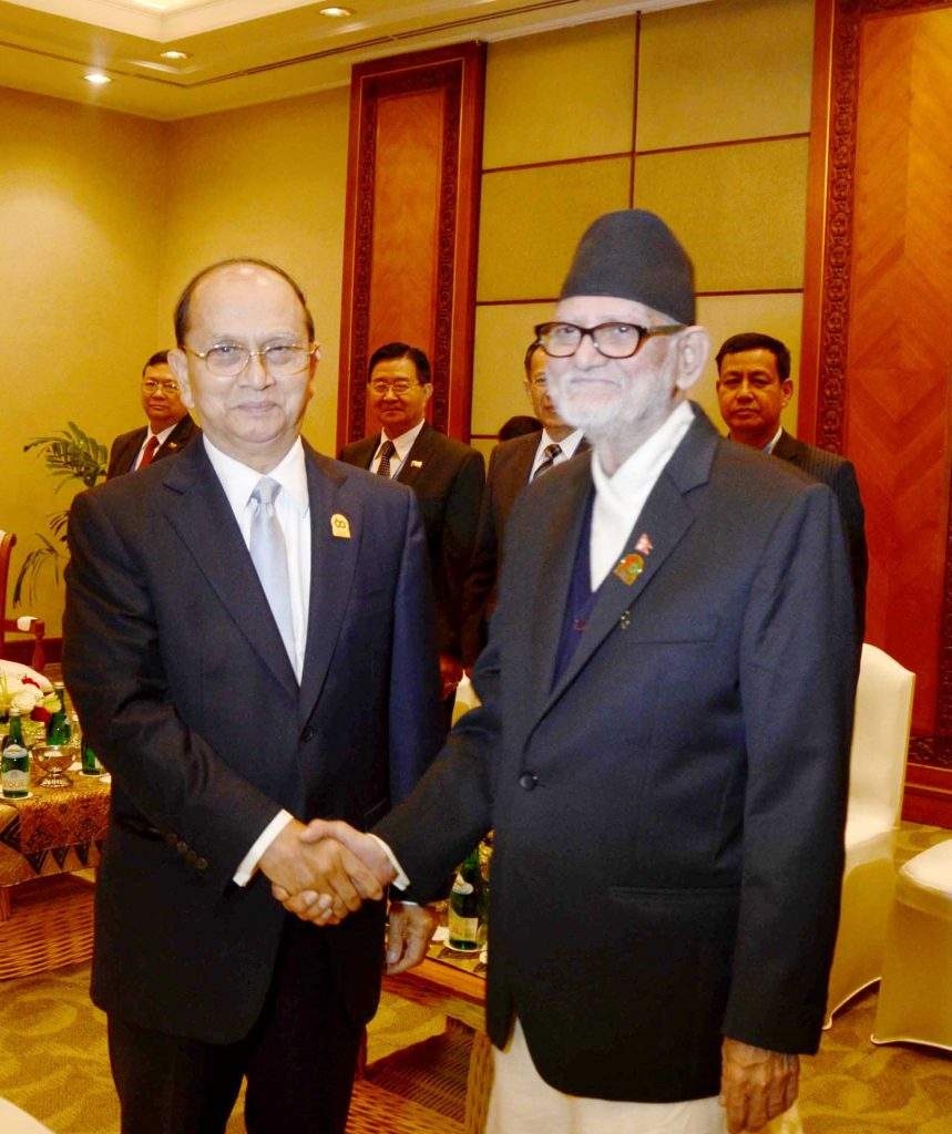 President  U Thein Sein shakes hands with Prime Minister Sushil  Koirala of the Federal Democratic Republic of Nepal.