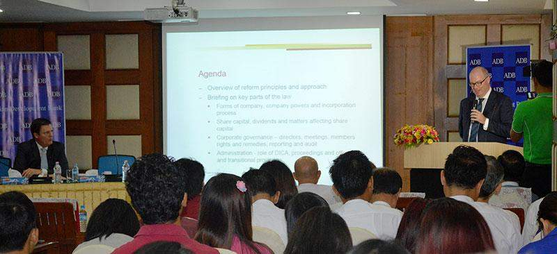 Mr Chris Hughes, managing partner of Baker & McKenzie, makes a  presentation on Myanmar Companies Act Reform at UMFCCI Building in Yangon on Tuesday.— Photo: Ye Myint